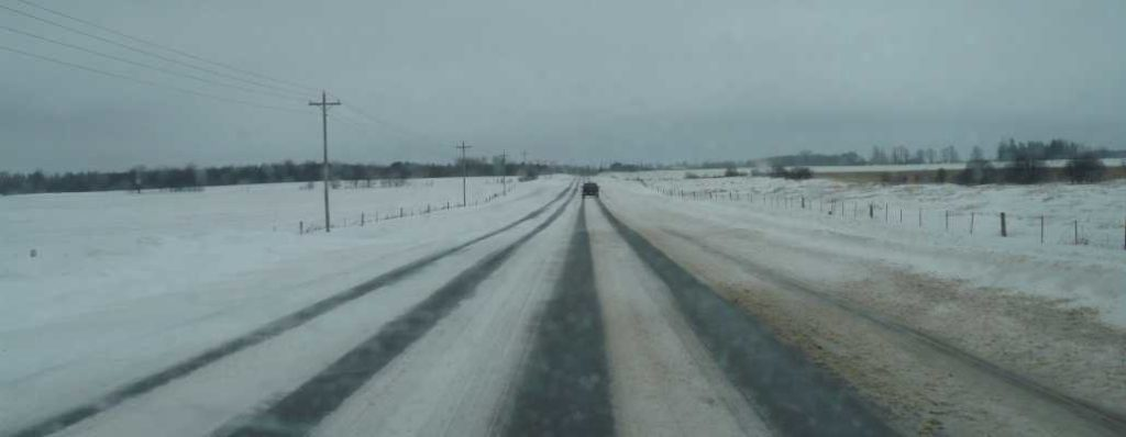 rural orangeville area snow covered road