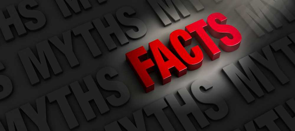 the word facts spotlighted surrounded by myths in darkness